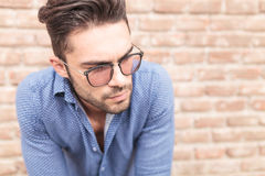 Closeup picture of a young casual man with glasses Royalty Free Stock Image