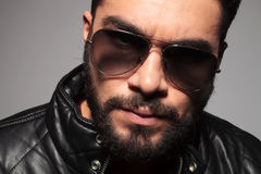 Closeup picture of a young man with long beard wearing sunglasse Stock Image