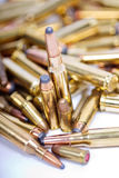 Closeup of pictures, piles of rifle bullets. Close-up of assorted bullets stock photography