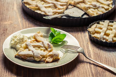 Closeup of piece of apple pie served with cream Royalty Free Stock Photos
