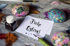 Happy easter in german and homemade easter eggs Royalty Free Stock Photo