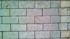 Closeup of a piece of white brick wall. Close-up of part of a brick wall. Rough white bricks in daylight royalty free stock photos