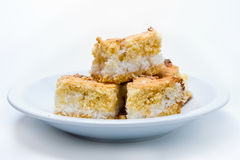 Closeup of pieces of a cononut cake isolated Stock Photo
