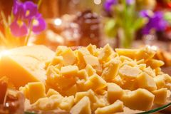 Closeup pieces of italian hard cheese parmesan at banguet. Concept tasting at cheese factory, catering, presentation in flower stock images