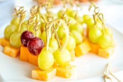 Closeup of pieces strawberry grapes designed - canape on table Stock Photos