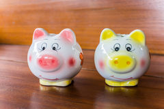 Closeup pig dolls  on wood Royalty Free Stock Photos
