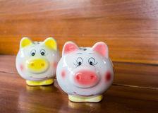 Closeup pig dolls  on wood Royalty Free Stock Images
