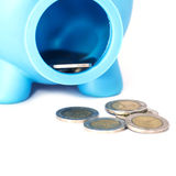 Closeup piggy bank with coins on white isolated background Royalty Free Stock Image