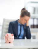 Closeup on piggy bank and frustrated businesswoman Stock Photography