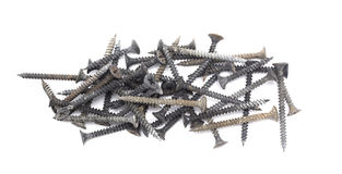 Closeup of a pile of black dirty screws isolated on white background Royalty Free Stock Image