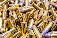 Closeup pile of bullets shiny stock photography