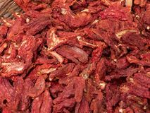 Closeup of pile of dried tomatoes. Like a textures in te background Stock Photo