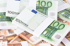 Closeup pile of fifty and one hundred euro banknotes. On white background Royalty Free Stock Photography