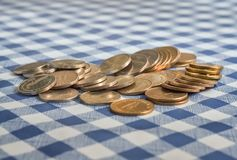 Pile of coins. Closeup of pile of macedonian denars scattered on the table Royalty Free Stock Images