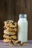 Closeup of pile made from homemade moms chocolate cookies and bottle of milk. vertical Royalty Free Stock Photo