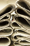 Closeup pile of newspaper Stock Photos