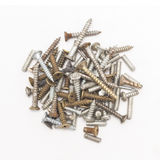Closeup of a pile of old rusty screws, isolated on white background Stock Photography