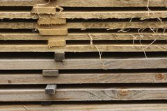 A pile of planks at a sawmill. Closeup of a pile of planks at a sawmill. The distance between the planks allows them to dry properly Royalty Free Stock Image