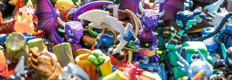 Closeup of pile of plastic characters for waste or consumption. Closeup of pile of plastic characters, dragons, knights, monsters and other small figurines sold Royalty Free Stock Photo
