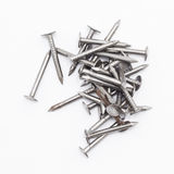 Closeup of a pile of rivets, nails isolated on white background Stock Photography