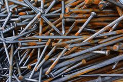 Closeup of pile of rusty nails. Closeup of pile of rusty and new nails Stock Photo
