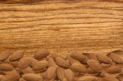 Closeup of a pile of shelled almonds on a rustic wooden table Royalty Free Stock Photos