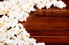 Closeup pile of white fluffy popcorn lying mixed together on wooden surface Stock Photo