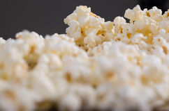 Closeup pile of white fluffy popcorn seen from low angle with grey background.  Royalty Free Stock Image