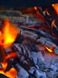 Closeup of pile of wood burning with flames. Fire. Royalty Free Stock Photography