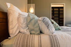 Closeup of pillows on bed in hotel room Royalty Free Stock Images