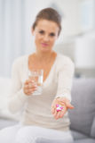Closeup on pills in hand of young woman Royalty Free Stock Image