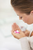 Closeup on pills in hand of young woman Royalty Free Stock Photo