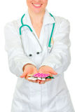 Closeup on pills on medical doctor woman hands Royalty Free Stock Photography