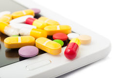 Closeup of pills on a tablet Stock Photo