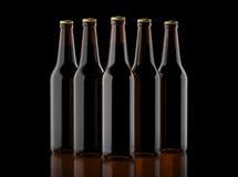 Closeup pin of brown beer bottles. 3D render, studio light, dark mirror background. Royalty Free Stock Images