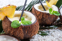 Closeup of pinacolada drink in the fresh coconut Royalty Free Stock Images