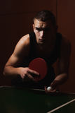 Closeup ping pong, table tennis player,. A serious young man in a black shirt, dark atmospheric style Stock Images