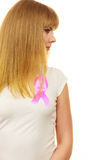 Closeup pink cancer ribbon on woman chest Royalty Free Stock Photos