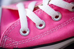 Closeup pink fashionable sneakers on shop shelf Stock Image