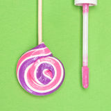 Closeup of pink lip gloss with lollipop Stock Images