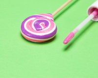 Closeup of pink lip gloss with lollipop Royalty Free Stock Photo