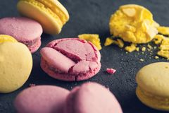 Closeup of pink macaroons on black concrete background Stock Photography