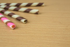 Closeup pink stripe wafer rolls. Royalty Free Stock Photo