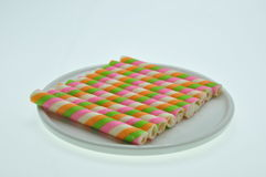 Closeup pink stripe wafer rolls on white Background Stock Photo