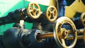 Closeup of pipes and faucet valves of heating system in a steam train.  stock footage