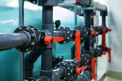 Pipes and valves in industrial plant Royalty Free Stock Images