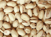 Closeup of pistachios in nut shells as food background Royalty Free Stock Photo