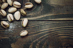 Closeup of pistachios nuts on wooden table Stock Photo