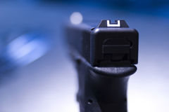 Closeup of pistol. A closeup view of the end and hand grip of a pistol with a shallow depth of field Royalty Free Stock Photo