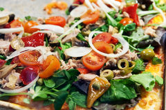 Closeup of pizza. Closeup pf pizza on pan in pizzeria Royalty Free Stock Image
